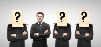Business concept. Four man with box on hand, business concept royalty free stock images