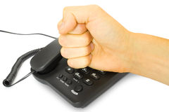 Business concept. Anger - business concept. fist with telephone Royalty Free Stock Image