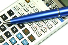 Business concept. Business / office concept shot, blue pen and a calculator Royalty Free Stock Image