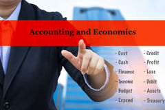 Business concept (Accounting and Economics). Businessman with blurre office building background royalty free stock images