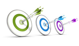 Business Concept - Achieving Multiple Strategic Objectives. Three colorful targets with arrows hitting the center, concept image for achieving business Royalty Free Stock Images