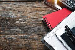Top view concept with agenda, mobile Phone,Tablet and calculator. stock images