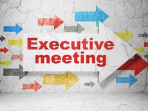 Business concept: arrow with Executive Meeting on grunge wall background. Business concept:  arrow with Executive Meeting on grunge textured concrete wall Stock Photography