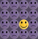 Business concept as a group of purple sad emoticons and with one individual yellow smiley Stock Images