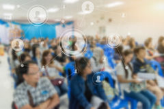 Business concept : asia people listen in business seminar presen. Tation hall of hotel room with social network connection icon symbol and blur filter,selective Royalty Free Stock Photography