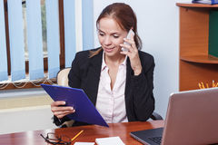 Business concept: attractive woman working with papers in the office Royalty Free Stock Photo