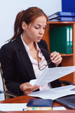 Business concept: attractive woman working with papers in the office Stock Photography