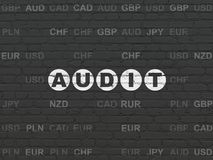 Business concept: Audit on wall background. Business concept: Painted white text Audit on Black Brick wall background with Currency Stock Photography