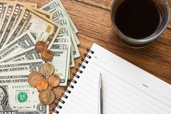Business concept background. Dollar bills with notebook and pen. Royalty Free Stock Photography