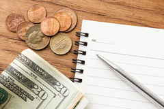 Business concept background. Dollar bills with notebook and pen. Stock Photography