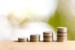 Business concept.Banking work. coins on table with trading bokeh background Royalty Free Stock Photos