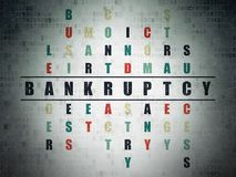 Business concept: Bankruptcy in Crossword Puzzle. Business concept: Painted black word Bankruptcy in solving Crossword Puzzle on Digital Data Paper background Royalty Free Stock Photos