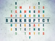 Business concept: Bankruptcy in Crossword Puzzle. Business concept: Painted blue word Bankruptcy in solving Crossword Puzzle on Digital Data Paper background Royalty Free Stock Image