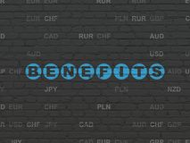 Business concept: Benefits on wall background. Business concept: Painted blue text Benefits on Black Brick wall background with Currency Royalty Free Stock Images