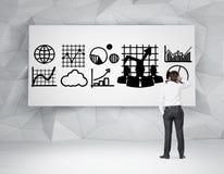 Business concept on blackboard. Businessman looking at drawing business concept on blackboard Stock Photos