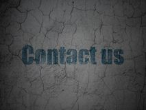Business concept: Contact us on grunge wall background. Business concept: Blue Contact us on grunge textured concrete wall background Stock Images