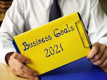 Business concept about Business Goals 2021 with phrase on the piece of paper