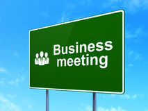 Business concept: Business Meeting and Business. People icon on green road (highway) sign, clear blue sky background, 3d render Royalty Free Stock Images