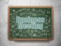 Business concept: Business Meeting on School board background. Business concept: Chalk Blue text Business Meeting on School board background with  Hand Drawn Stock Images