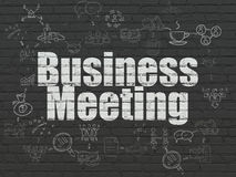 Business concept: Business Meeting on wall background. Business concept: Painted white text Business Meeting on Black Brick wall background with Scheme Of Hand Stock Photography