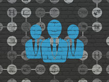Business concept: Business People on wall. Business concept: Painted blue Business People icon on Black Brick wall background with Scheme Of Hand Drawn Business Royalty Free Stock Image