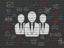 Business concept: Business People on wall. Business concept: Painted white Business People icon on Black Brick wall background with Scheme Of Hand Drawn Business Royalty Free Stock Photos