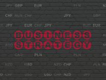 Business concept: Business Strategy on wall background. Business concept: Painted red text Business Strategy on Black Brick wall background with Currency Stock Image