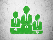 Business concept: Business Team on wall background. Business concept: Green Business Team on textured concrete wall background Royalty Free Stock Image