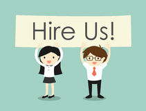 Business concept, Business woman and businessman holding Hire Us! banner. Stock Images