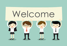 Business concept, Businessman and business women holding 'Welcome' signboard with green background. Stock Photography