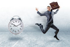 The business concept with businessman and clock Royalty Free Stock Images