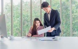 Businessman explain job details to businesswoman royalty free stock images