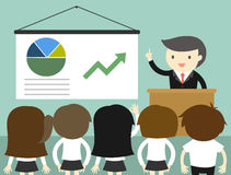 Business concept, Businessman giving presentation and explaining charts. Royalty Free Stock Images