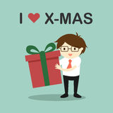 Business concept, Businessman holding a gift box with the words I love X-mas. Stock Photos