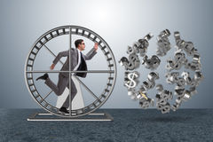 The business concept with businessman running on hamster wheel. Business concept with businessman running on hamster wheel Stock Image