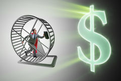 The business concept with businessman running on hamster wheel Royalty Free Stock Image