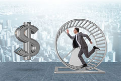 The business concept with businessman running on hamster wheel Stock Photo