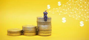 Business concept. Businessman sitting on a pile of silver coins.  stock photography