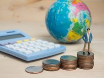 Business Concept. businessman small  figures standing on calcula Stock Photography