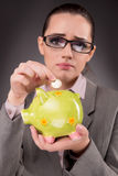 The business concept with businesswoman and piggy bank Royalty Free Stock Photos