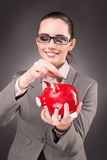 The business concept with businesswoman and piggy bank Stock Image