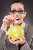 The business concept with businesswoman and piggy bank Royalty Free Stock Image