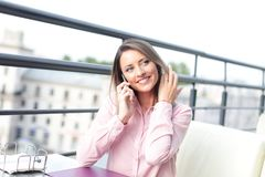 Business concept - businesswoman talking on the phone. In office Stock Photography