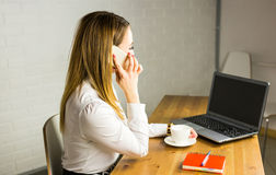 Business concept - businesswoman talking on the phone in office Stock Photos
