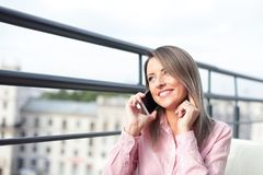 Business concept - businesswoman talking on the phone. In office Royalty Free Stock Photo
