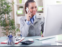 Business concept - businesswoman talking on the phone in office Royalty Free Stock Photography