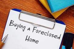 Business concept about Buying a Foreclosed Home with phrase on the page