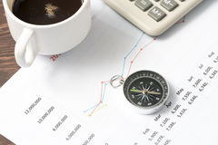 Business concept with calculator, clock and compass on documents Royalty Free Stock Photo
