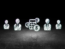Business concept: calculator icon in grunge dark. Business concept: row of Glowing business man icons around calculator icon in grunge dark room Dirty Floor Stock Photography