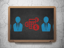 Business concept: calculator icon on School Board. Business concept: row of Painted blue business man icons around red calculator icon on School Board background Stock Images